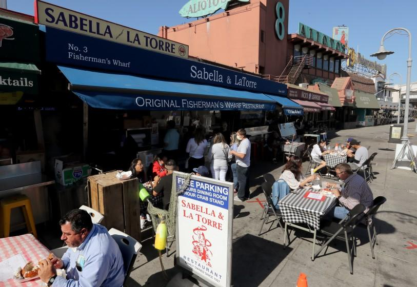 SAN FRANCISCO CA - OCT. 23, 2020. Customers dine in outdoor eating areas at Fishermen's Wharf in San Francisco on Friday, Aug. 23, 2020. San Francisco has done an excellent job following public health guidance and made a huge leap from the coronavirus orange tier to the less restrictive yellow tier, providing a pathway for more businesses and activities to reopen. (Luis Sinco / Los Angeles Times)