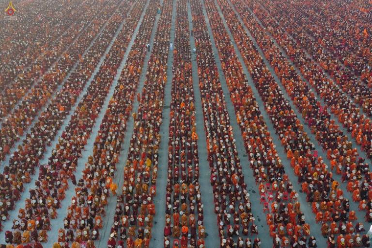 As the sun rose over the ancient town of Mandalay in Myanmar, a sea of saffron and maroon-robed monks assembled in an area the size of a football field