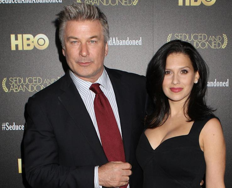 "FILE - In this Oct. 24, 2013 file photo, producer and actor Alec Baldwin and wife Hilaria Baldwin attend the HBO premiere of ""Seduced and Abandoned"" at The Time Warner Center, in New York. Baldwin is putting a twist on his rocky relationship with the media: He's playing a meddling newspaperman on a NBC drama. The network said Tuesday, Feb. 25, 2014, that Baldwin guest stars as a New York columnist on ""Law & Order: Special Victims Unit,"" airing March 19, 2014. (Photo by Greg Allen/Invision/AP, file)"