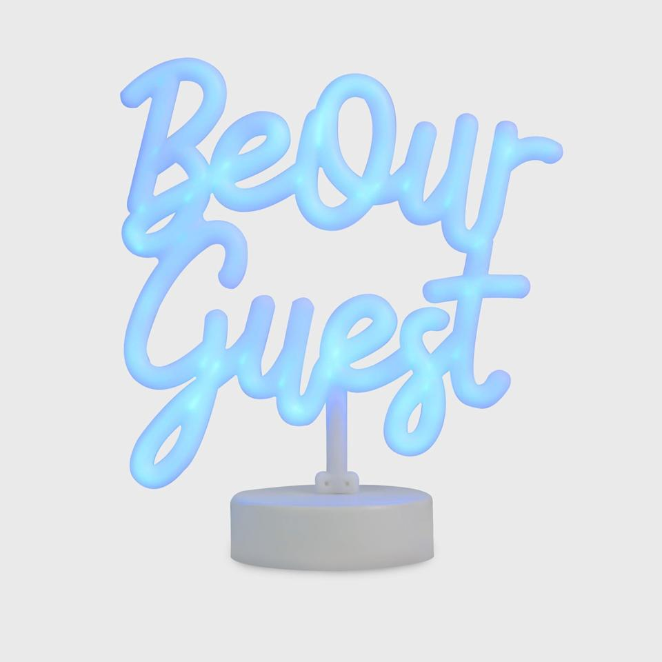 <p>They can welcome friends over with this <span>Disney Princess X POPSUGAR Belle Be Our Guest Neon Desktop Lamp</span> ($40) or use it for mood lighting in their dorm room.</p>