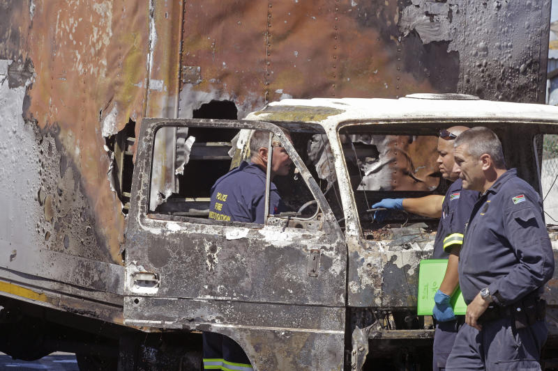 Man torched in SAfrica mine strikes, another shot
