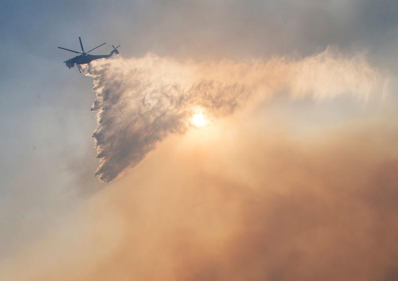 Firefighters battle to protect area around the Reagan Library from the Easy Fire in Simi Valley, California on Oct. 30, 2019. (Photo: Mark Ralston/AFP via Getty Images)