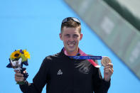 Hayden Wilde of New Zealand holds his bronze medal during a medal ceremony for the men's individual triathlon at the 2020 Summer Olympics, Monday, July 26, 2021, in Tokyo, Japan. (AP Photo/Jae C. Hong)