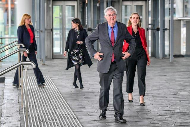 Wales First Minister Mark Drakeford arrives at the Senedd in Cardiff Bay (PA)