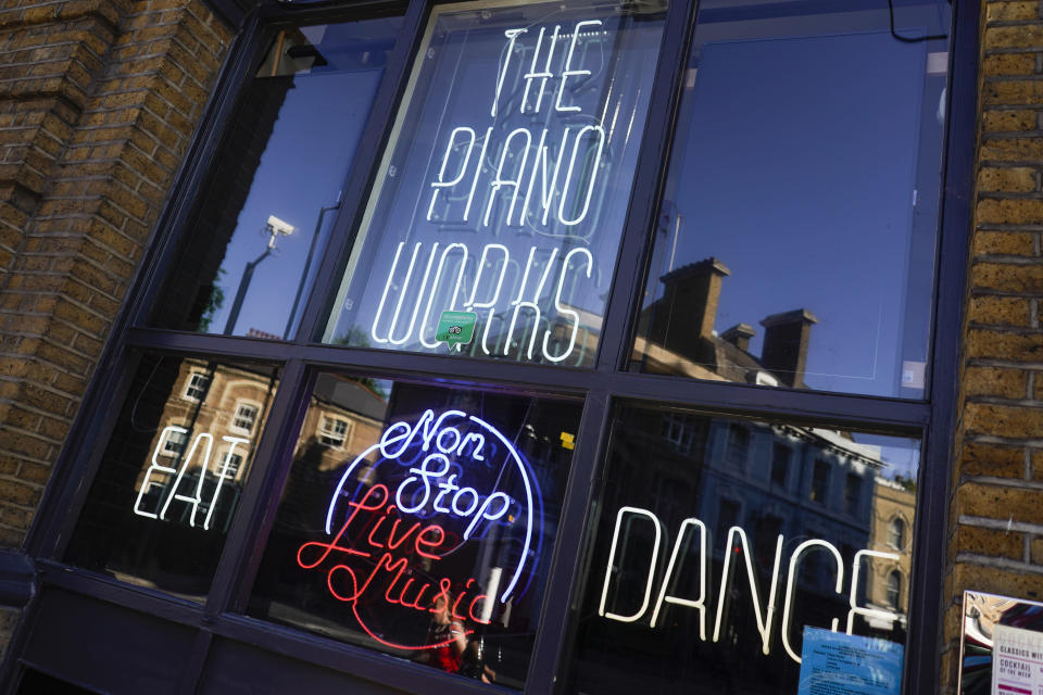 """The Piano Works club in Farringdon, London, Friday, July 16, 2021, ahead of the reopening of nightclubs, as part of the relaxation of COVID-19 restrictions. Thousands of young people plan to dance the night away at """"Freedom Day"""" parties as the clock strikes midnight Monday, when almost all coronavirus restrictions in England are due to be scrapped. Nightclubs can open fully and are not required to use vaccine passports. (AP Photo/Alberto Pezzali)"""