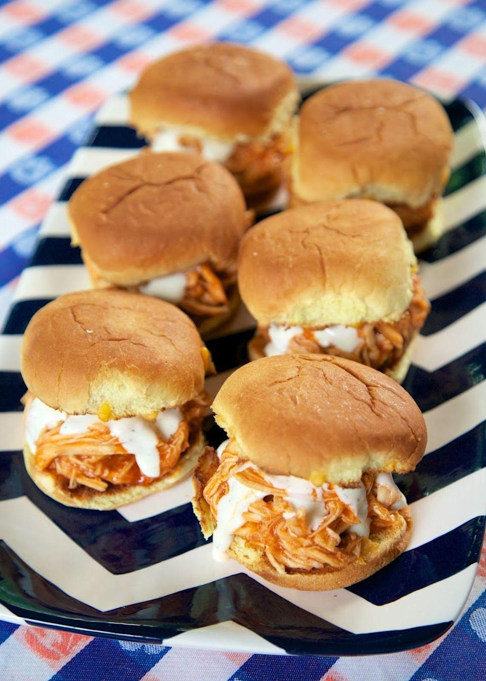 """<p>These zesty and creamy sliders can be made in your slow-cooker, and no one is going to argue with less work.</p><p>Get the recipe from <a href=""""http://www.plainchicken.com/2015/01/slow-cooker-buffalo-chicken-sliders.html"""" rel=""""nofollow noopener"""" target=""""_blank"""" data-ylk=""""slk:Plain Chicken"""" class=""""link rapid-noclick-resp"""">Plain Chicken</a>.</p>"""