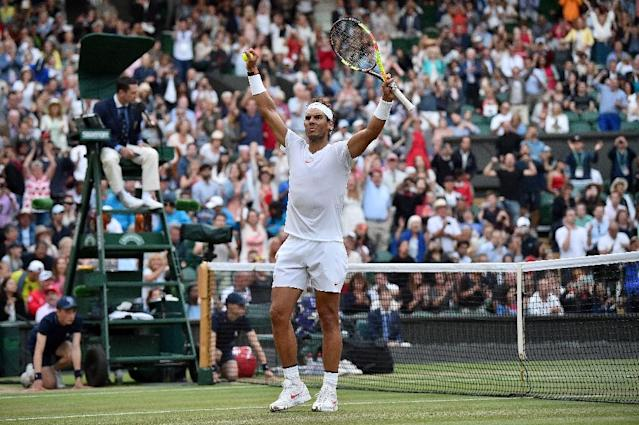 Epic win: Rafael Nadal celebrates after winning against Juan Martin del Potro (AFP Photo/Glyn KIRK )