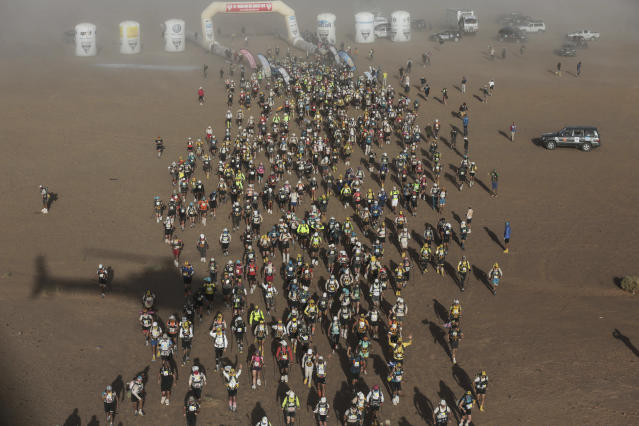 An aerial photo shows competitors taking part in the 33rd edition of Marathon des Sables, in the Sahara desert, near Merzouga, southern Morocco, Friday, April 13, 2018. Under a hot desert sun and with the desolation of the Sahara all around, about 1,000 competitors from 50 countries took part in this year's Marathon des Sables, or Marathon of the Sands. The 33rd edition of the annual race, considered to be one of the most demanding ultramarathons in the world, finished Saturday after six grueling days and about 250 kilometers (150 miles). (AP Photo/Mosa'ab Elshamy)