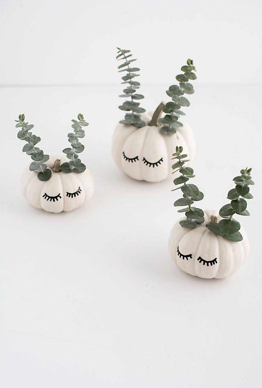"""<p>These modern mini pumpkins can make a statement in any room of the house, especially with sprigs of eucalyptus designed to look like animal antlers or ears. </p><p><strong>Get the tutorial at <a href=""""https://www.homeyohmy.com/diy-cute-faced-mini-pumpkins/"""" rel=""""nofollow noopener"""" target=""""_blank"""" data-ylk=""""slk:Homey Oh My"""" class=""""link rapid-noclick-resp"""">Homey Oh My</a>.</strong> </p>"""