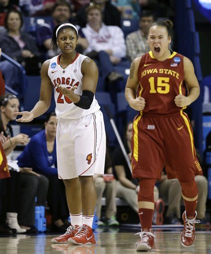 """Georgia's Shacobia Barbee, left, and Iowa States's Nicole """"Kidd"""" Blaskoway both react to an out-of-bounds call in favor of Iowa State in the first half of a second-round game in the women's NCAA college basketball tournament in Spokane, Wash., Monday, March 25, 2013. (AP Photo/Elaine Thompson)"""
