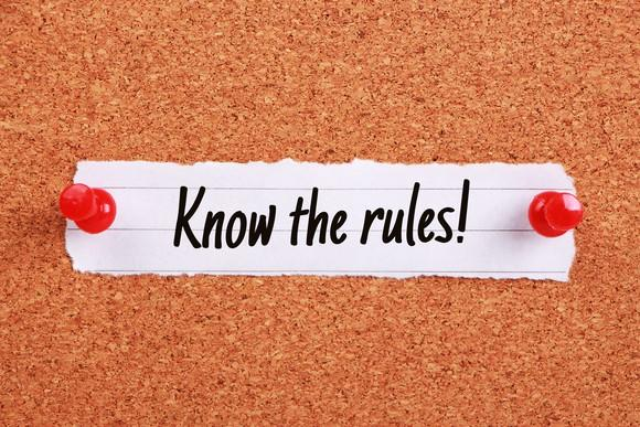 the words know the rules printed on a small piece of paper pinned to a corkboard