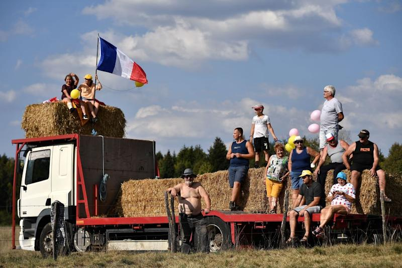 Spectators wait for the riders during the 19th stage of the 107th edition of the Tour de France cycling race 160 km between BourgenBresse and Champagnole on September 18 2020 Photo by AnneChristine POUJOULAT AFP Photo by ANNECHRISTINE POUJOULATAFP via Getty Images