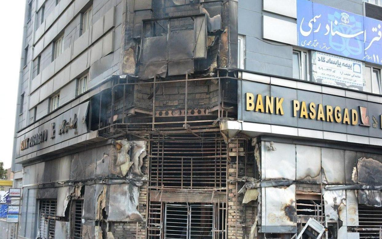 Buildings have been set ablaze by protesters during a demonstration against a rise in gasoline prices in Eslamshahr - AFP