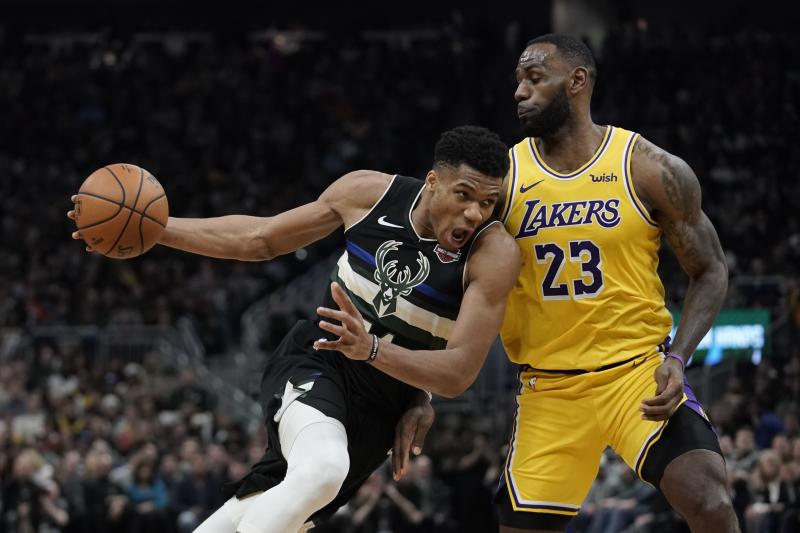 Milwaukee Bucks' Giannis Antetokounmpo tries to drive past Los Angeles Lakers' LeBron James during the second half of an NBA basketball game Thursday, Dec. 19, 2019, in Milwaukee. The Bucks won 111-104. (AP Photo/Morry Gash)
