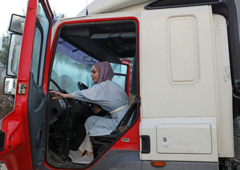 Palestinian Dalia al-Darawish prepares for her exam to become a truck driver in the West Bank town of Hebron