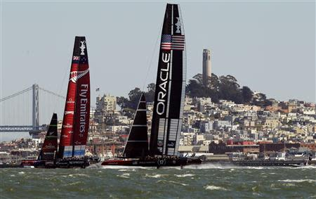 Emirates Team New Zealand holds a lead over Oracle Team USA during Race 10 of the 34th America's Cup yacht sailing race in San Francisco, California