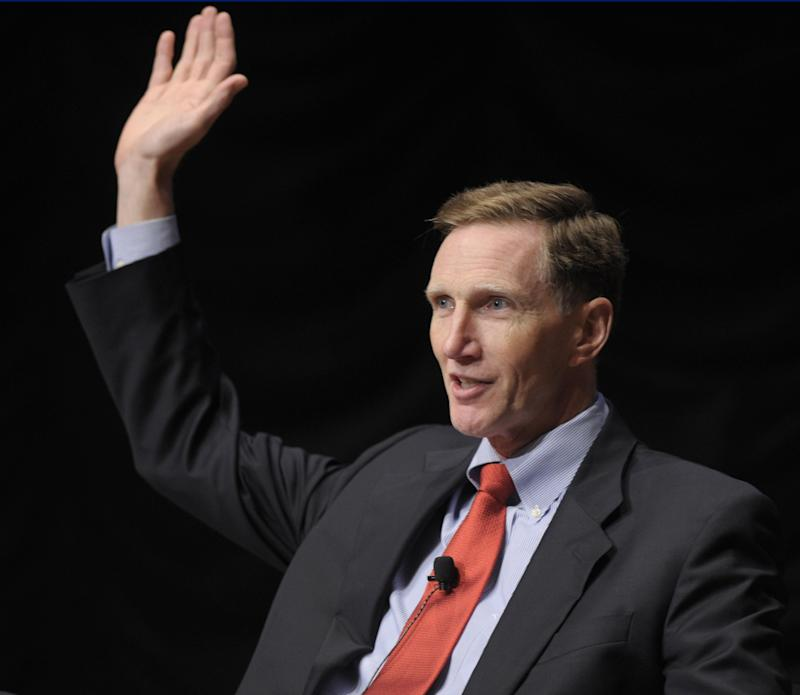 In this Sept. 7, 2011, photo, Transportation Security Administration Administrator John Pistole, who asked audience members to raise their hands if they have gone through an airport body scanner,  speaks at the Intelligence and National Security Alliance conference in Washington, Wednesday, Sept. 7, 2011. Pistole, who for decades as an FBI agent breezed past airport security checkpoints, is the faceless bane of air travelers who must remove belts, endure an intimate pat-down or are instructed to throw away a perfectly good 6-ounce bottle of shampoo. (AP Photo/Susan Walsh)