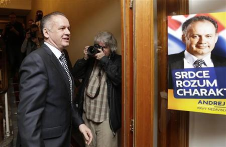 Slovakia's presidential candidate Andrej Kiska (L) arrives at a party election headquarters to observe the ongoing election results in Bratislava March 29, 2014. REUTERS/David W Cerny