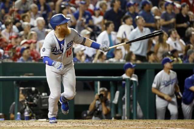 Los Angeles Dodgers' Justin Turner watches his three-run home run in the eighth inning of a baseball game against the Washington Nationals, Friday, July 26, 2019, in Washington. (AP Photo/Patrick Semansky)