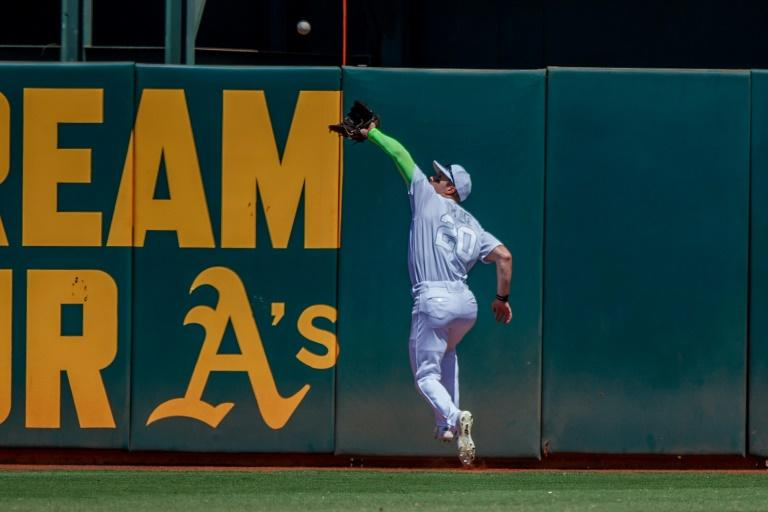 MLB's Athletics return to play Friday after virus layoff