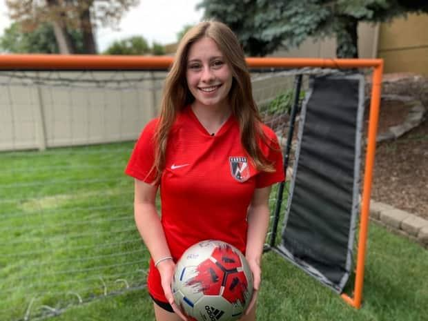 Avery Comartin, a Grade 12 student who is set to enter Holy Names Catholic High School in Windsor, has been dreaming of getting a scholarship to an NCAA school, but border issues are interfering with her goal.  (Darrin Di Carlo/CBC - image credit)