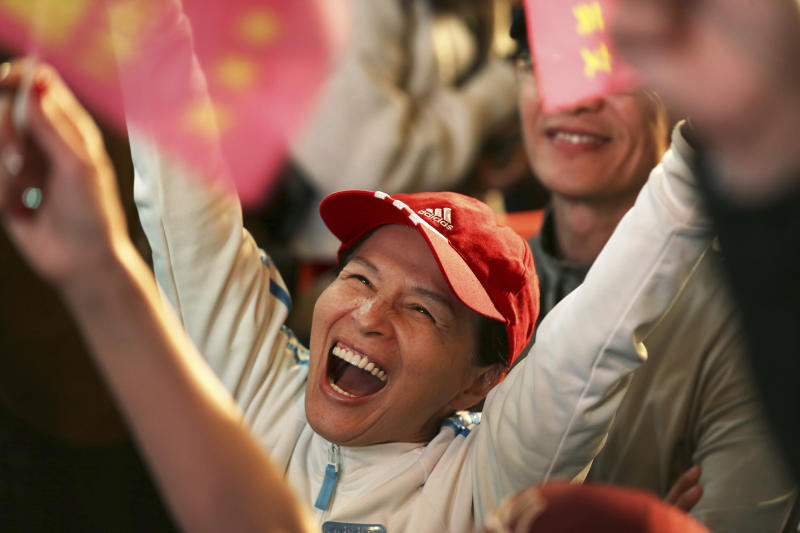 A supporter of Taiwan's 2020 presidential election candidate, Taiwan president Tsai Ing-wen cheers for Tsai's victory in Taipei, Taiwan, Saturday, Jan. 11, 2020. (AP Photo/Chiang Ying-ying)