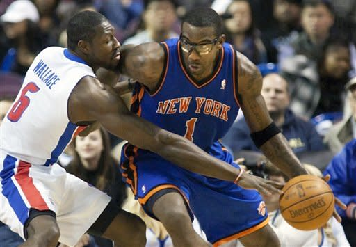 Detroit Pistons' Ben Wallace (6) knocks the ball away from New York Knicks' Amr'e Stoudemire (1) in the second half of an NBA basketball game Saturday, Jan. 7, 2012, in Auburn Hills, Mich. The Knicks defeated the Pistons 103-80. (AP Photo/Duane Burleson)