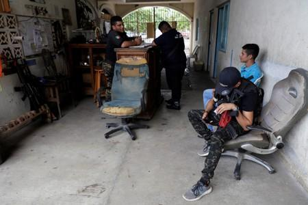 Vigilantes are pictured at the command headquarters in the municipality of Coahuayana