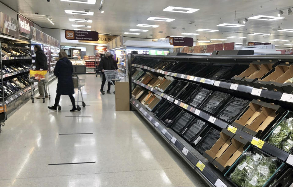 "Depleted shelves are seen in a Sainsbury's supermarket at the Forestside shopping centre in Belfast, Monday, Jan. 11, 2021. The U.K.'s biggest supermarket chains warned Wednesday, Jan. 13 that food supplies in Northern Ireland face disruption because of new checks imposed by Britain's departure from the European Union. After photos emerged showing empty shelves, the chief executives of Tesco, Sainsbury's, Asda, Iceland, Co-Op and Marks & Spencer wrote to the government saying there would be ""significant disruption"" unless urgent action was taken to fix an ""unworkable"" system. (David Young/PA via AP)"