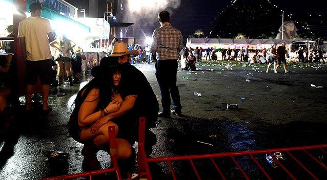 People take cover at the festival. Source: Getty Images