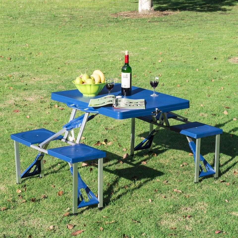 "<h3>Folding Picnic Table Set</h3> <br>Or, if you're camping with a crew, try picking up a portable seating set (like this on-sale picnic table option) that makes group dining on-the-go a much easier feat. <br><br><strong>Outsunny</strong> Folding Picnic Table Set, $, available at <a href=""https://go.skimresources.com/?id=30283X879131&url=https%3A%2F%2Fwww.walmart.com%2Fip%2FOutsunny-4-Person-Plastic-Portable-Compact-Folding-Suitcase-Picnic-Table-Set-with-Umbrella-Hole-Simple-Setup-Process-Blue%2F108030088"" rel=""nofollow noopener"" target=""_blank"" data-ylk=""slk:Walmart"" class=""link rapid-noclick-resp"">Walmart</a><br>"