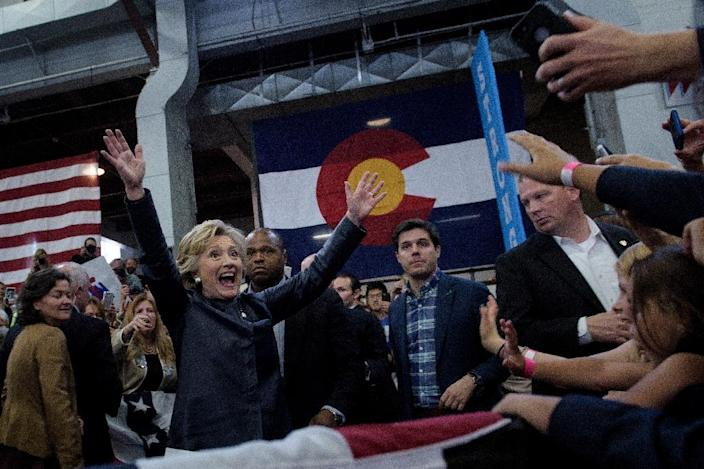 Democratic presidential nominee Hillary Clinton walks to supporters after speaking during a Colorado Democratic party rally in the Palace of Agriculture at the state fairgrounds October 12, 2016 in Pueblo, Colorado (AFP Photo/Brendan Smialowski)