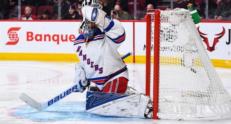 Henrik Lundqvist has been allowing more clear-sighted goals than usual this season. (Minas Panagiotakis/Getty Images)