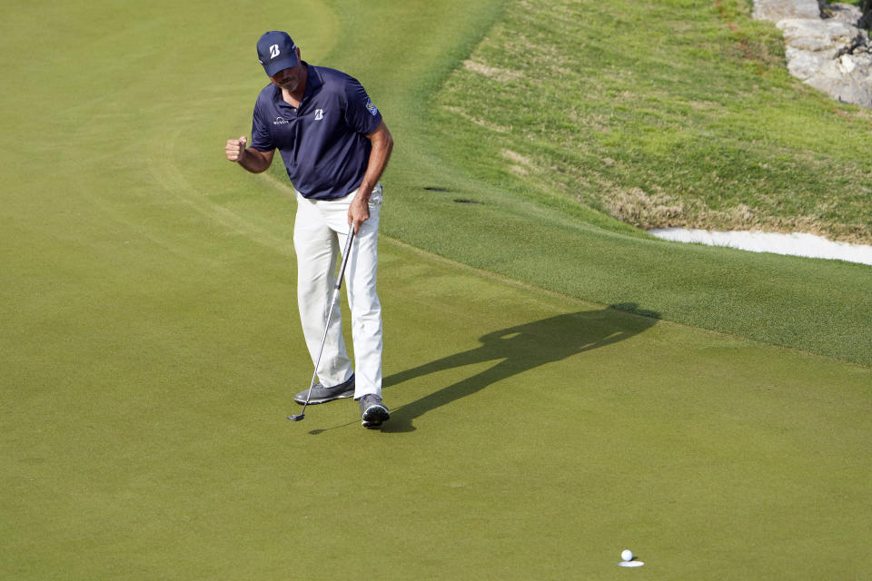 Matt Kuchar makes his birdie putt on the 17th green to beat Brian Harman in their round of eight match at the Dell Technologies Match Play Championship golf tournament Saturday, March 27, 2021, in Austin, Texas. (AP Photo/David J. Phillip)