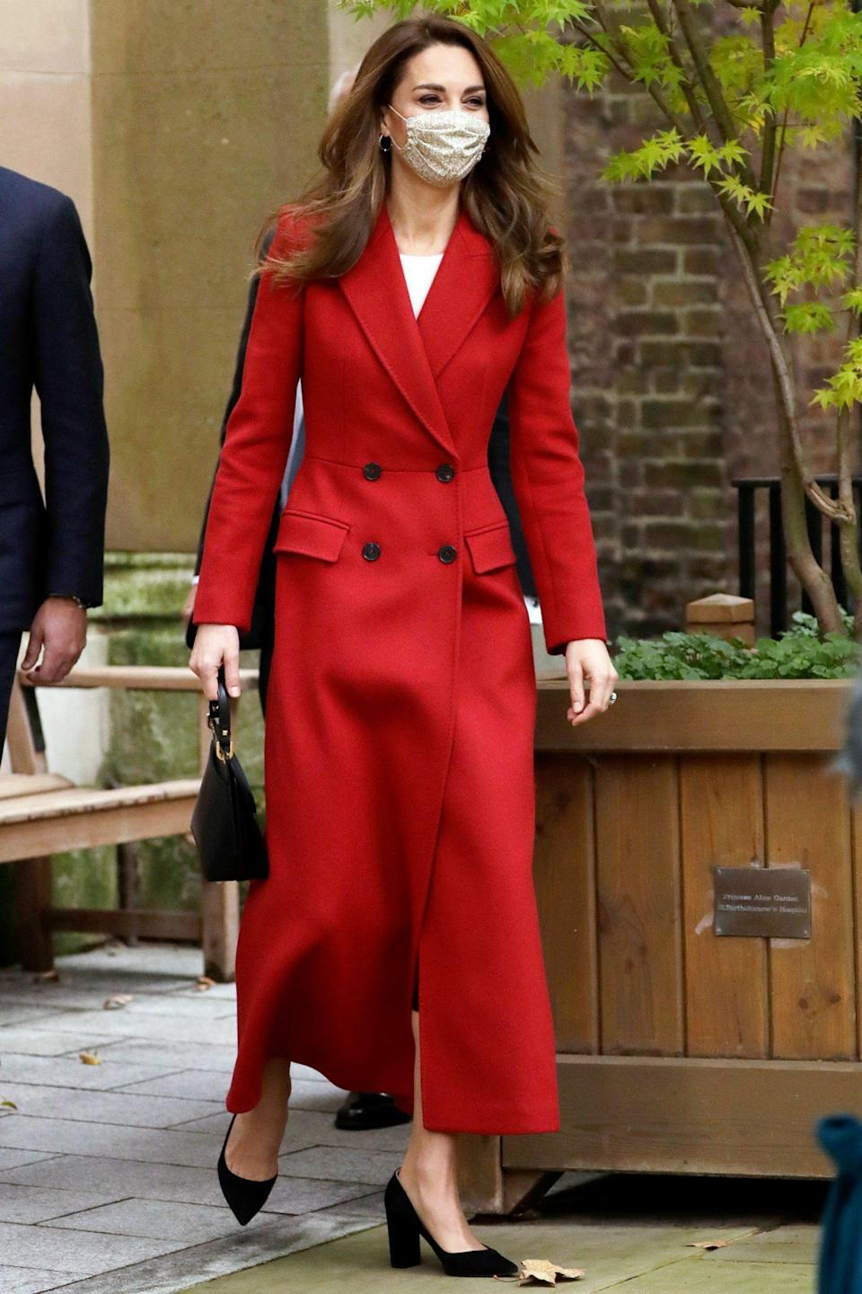 <p>Kate Middleton, Duchess of Cambridge, arrives at St. Bartholomew's Hospital on Monday in London for the launch of Hold Still, a nationwide community photography project. </p>