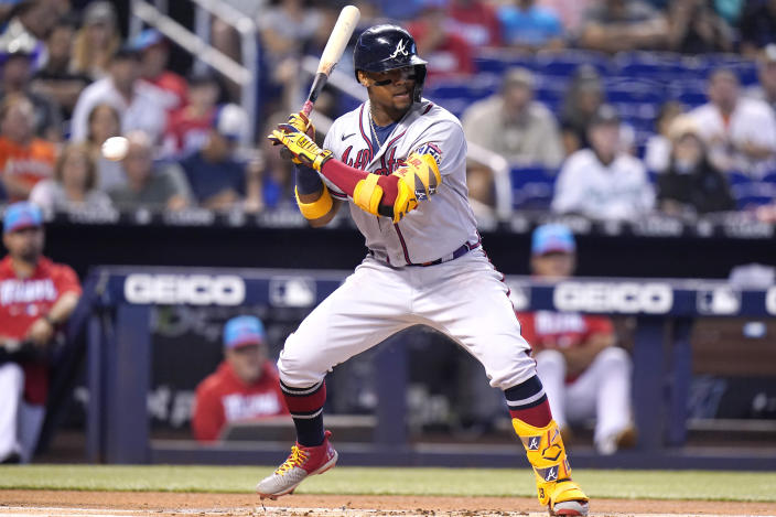 Atlanta Braves' Ronald Acuna Jr. takes ball four for a walk during the first inning of a baseball game against the Miami Marlins, Saturday, July 10, 2021, in Miami. (AP Photo/Lynne Sladky)