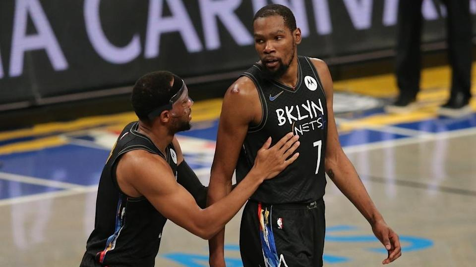 Nets Kevin Durant held by Bruce Brown black jerseys