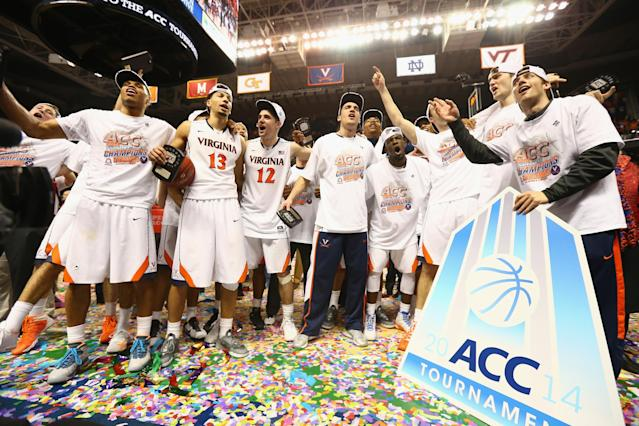 GREENSBORO, NC - MARCH 16: The Virginia Cavaliers celebrate after defeating the Duke Blue Devils to win the the championship game of the 2014 Men's ACC Basketball Tournament at Greensboro Coliseum on March 16, 2014 in Greensboro, North Carolina. (Photo by Streeter Lecka/Getty Images)