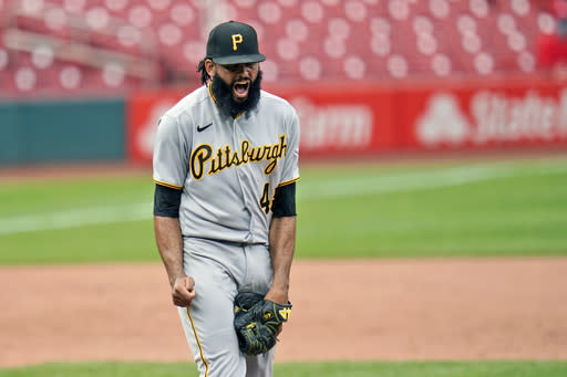 Pittsburgh Pirates relief pitcher Richard Rodriguez celebrates after striking out St. Louis Cardinals' Max Schrock for the final out in the first game of a baseball doubleheader Thursday, Aug. 27, 2020, in St. Louis. The Pirates won 4-3. (AP Photo/Jeff Roberson)