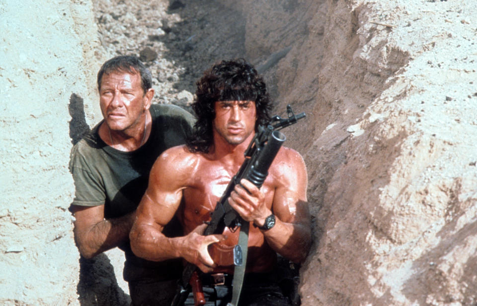 Sylvester Stallone walks through a trench with Richard Crenna in a scene from the film 'Rambo III', 1988. (Photo by TriStar/Getty Images)