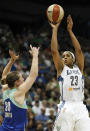 Minnesota Lynx forward Maya Moore (23) takes a shot against New York Liberty guard Katie Smith (30) in the second half of a WNBA basketball game, Sunday, Aug. 18, 2013, in Minneapolis. The Lynx won 88-57 and Moore scored 28points. (AP Photo/Stacy Bengs)