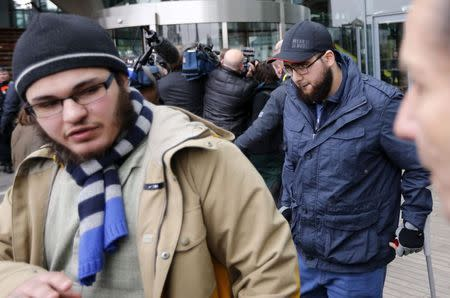 """Walid Lakdim and Bilal El Makhoukhi (R), who are convicted of being part of """"Sharia4Belgium"""", leave after the verdict is delivered in a trial of the group in Antwerp February 11, 2015. REUTERS/Francois Lenoir"""