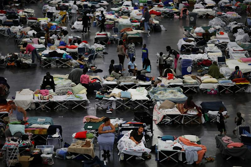After Hurricane Harvey struck the Houston area, evacuees find shelter at the George R. Brown Convention Center. Many evacuees did not have time to grab medications before having to flee the floodwaters. (Carlos Barria / Reuters)