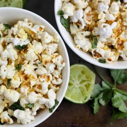 """<div class=""""caption-credit""""> Photo by: Bake Your Day</div><div class=""""caption-title"""">Cilantro Lime Popcorn</div>A twist of lime makes this popcorn bright and refreshing. <br> <a href=""""http://www.bakeyourday.net/cilantro-lime-popcorn/"""" rel=""""nofollow noopener"""" target=""""_blank"""" data-ylk=""""slk:Get the recipe"""" class=""""link rapid-noclick-resp""""><i>Get the recipe</i></a> <br> <b>More on Spoonful</b> <br> <a href=""""http://spoonful.com/recipes/fun-party-foods?cmp=ELP