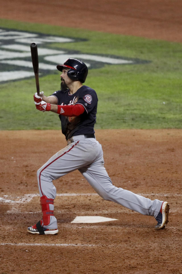 Washington Nationals' Anthony Rendon watches his home run against the Houston Astros during the seventh inning of Game 7 of the baseball World Series Wednesday, Oct. 30, 2019, in Houston. (AP Photo/Sue Ogrocki)