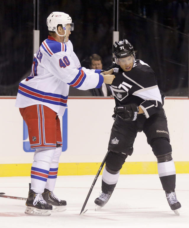 New York Rangers center Brandon Mashinter (40) grabs Los Angeles Kings center Jordan Nolan (71) to fight in the second period of a preseason NHL hockey game, Friday, Sept. 27, 2013 in Las Vegas. Mashinter was called for a penalty on the play. (AP Photo/Julie Jacobson)