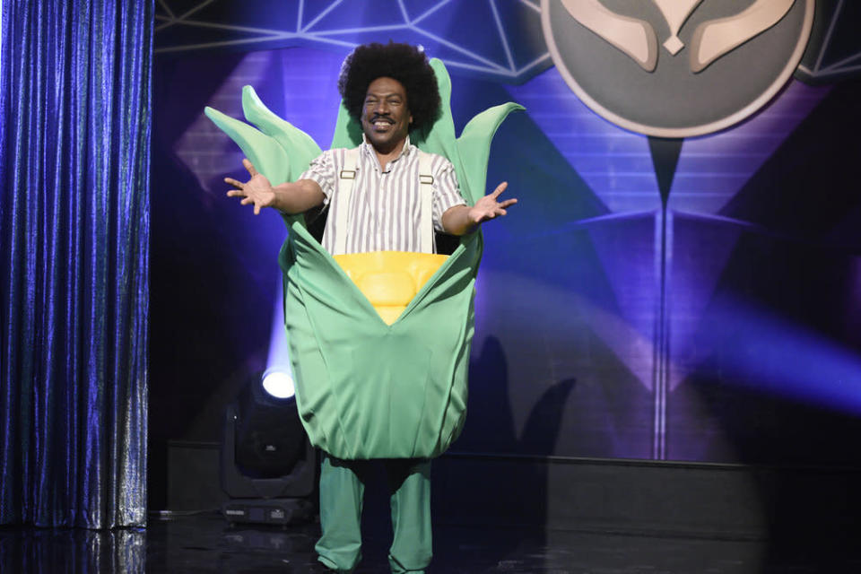 """This image released by NBC shows Eddie Murphy as Buckwheat during the """"Masked Singer"""" Sketch on """"Saturday Night Live."""" Murphy won the award for outstanding guest actor in a comedy series during the Creative Arts Emmy Awards on Saturday, Sept. 19, 2020. (Will Heath/NBC via AP) SATURDAY NIGHT LIVE -- """"Eddie Murphy"""" Episode 1777 -- Pictured: Host Eddie Murphy as Buckwheat during the """"Masked Singer"""" Sketch on Saturday, December 21, 2019 -- (Photo by: Will Heath/NBC)"""
