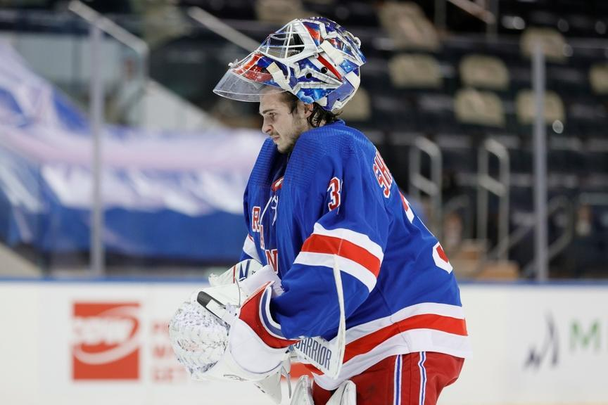 Igor Shesterkin with his goalie mask up during a game against the Penguins