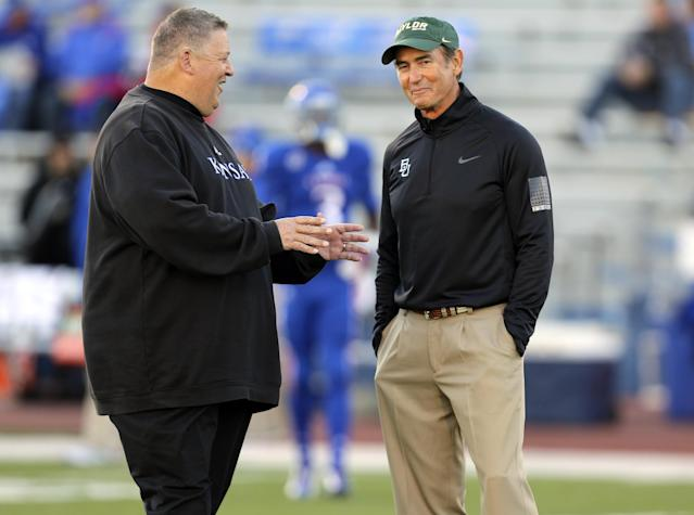 Kansas Jayhawks head coach Charlie Weis, left, and Baylor Bears head coach Art Briles talk prior to an NCAA college football game Saturday, Oct. 26, 2013, in Lawrence, Kan. (AP Photo/Ed Zurga)