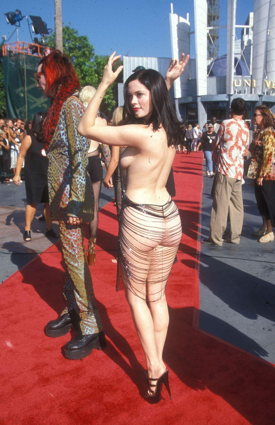 <p>That L.A. heat had nothing on Rose McGowan who was wearing breezy attire to the show in 1998. We've got all sorts of questions with this one.</p>